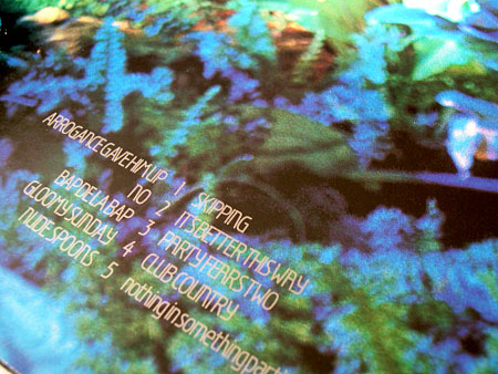 ^ Tracklisting from rear of the original UK vinyl album - silver ink print