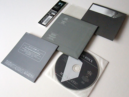 Backs of the cover, insert, booklet, obi, plus disc label