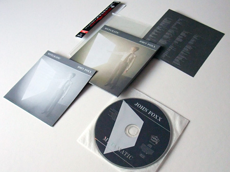 Fronts of the cover, insert, booklet, obi and label design