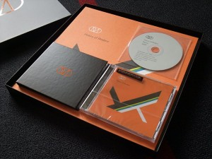 Box opened, the 2 CDs and the DVD, art print behind