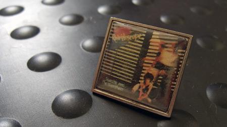 'Kaleidoscope' era metal badge