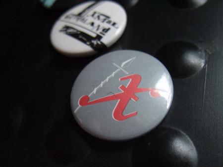 Xmal Deutschland badge design - grey/red 'Matador' era