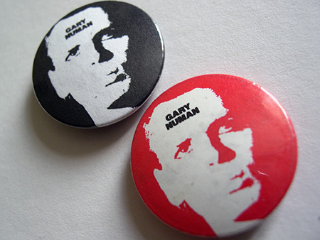 Gary Numan button badge design variants - black/black and red/black