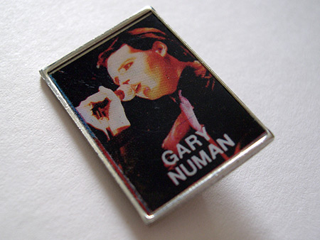 Gary Numan metal lapel badge with 1979 'Touring Principle' era live shot