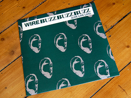 Wire 'Buzz Buzz Buzz (Live Live Live) limited edition 12 inch single front cover design