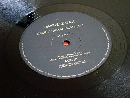 Danielle Dax 'Fizzing Human Bomb'/'Yummer Yummer Man'/'Bad Miss M' double A side 12 inch single - label design side A