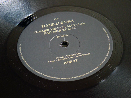 Danielle Dax 'Fizzing Human Bomb'/'Yummer Yummer Man'/'Bad Miss M' double A side 12 inch single - label design side AA