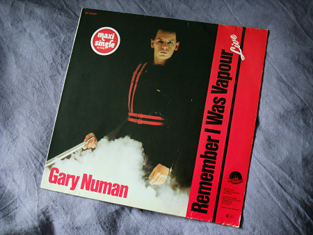 "Gary Numan - 'Remember I Was Vapour' (Live) West German 12"" front cover design"