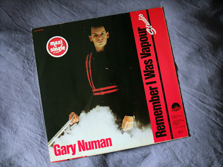 "Gary Numan - 'Remember I Was Vapour' (Live) West German 12"" rear cover design"