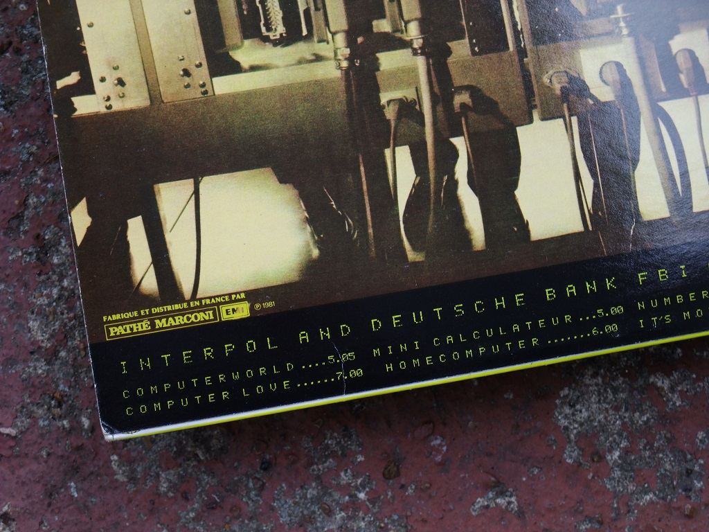 Kraftwerk - 'Computer World' Pathe-Marconi EMI French vinyl LP, 1981 - rear sleeve design titles detail including 'Mini Calculateur'.