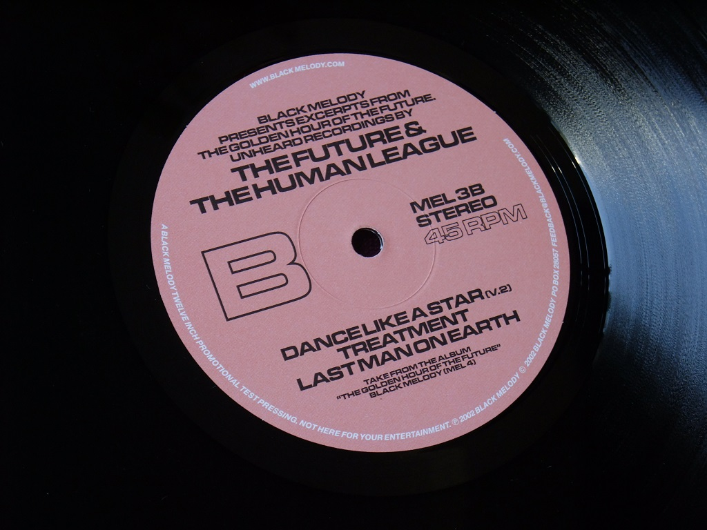"'Black Melody Presents Excerpts From The Golden Hour Of The Future. Unearthed Recordings By The Future & The Human League' 12"" EP label side B"
