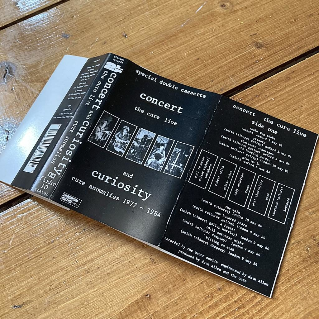 The Cure 'Concert and Curiosities' UK cassette inlay side 1