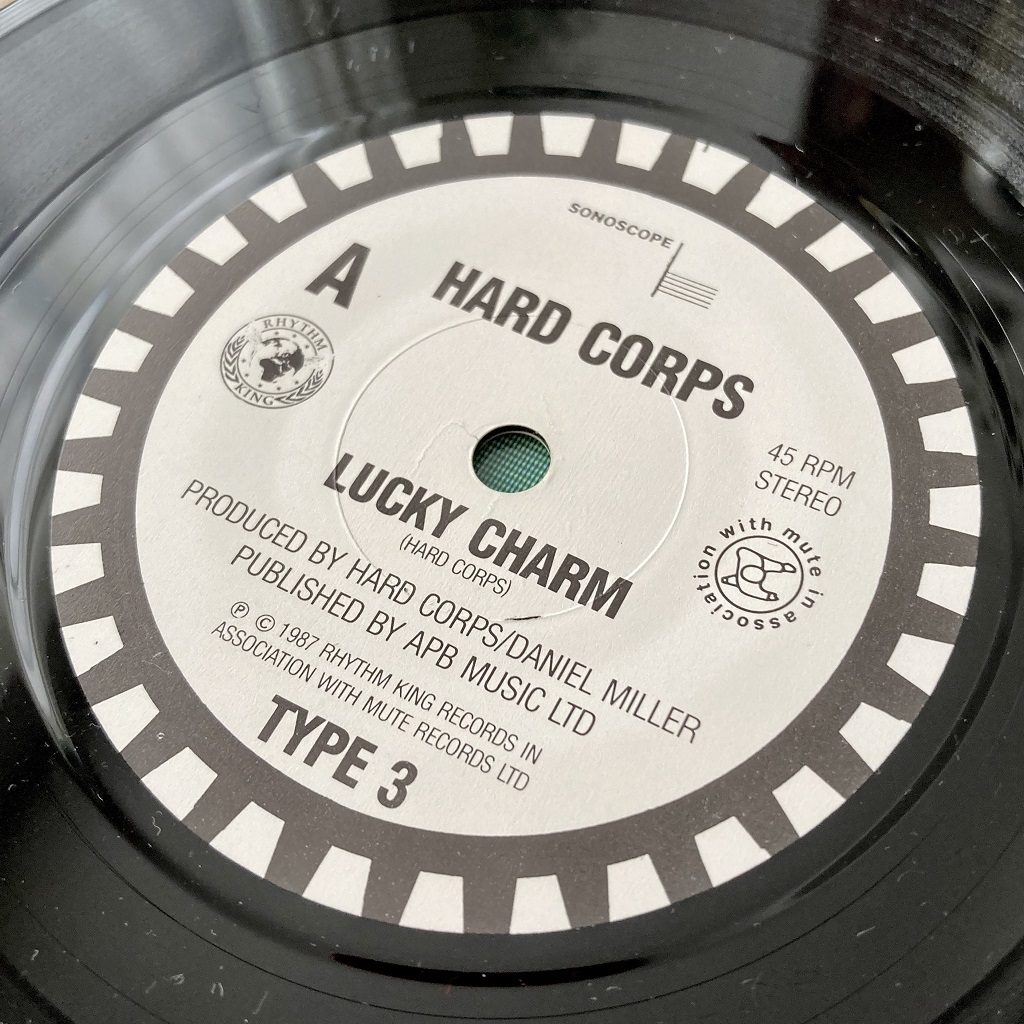 Hard Corps - Lucky Charm UK 7 inch single label A