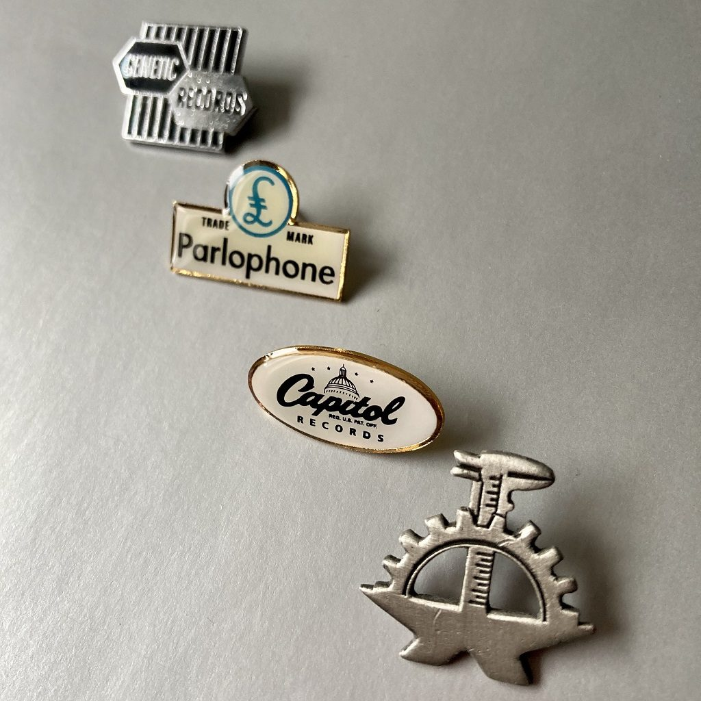 Various record company logo badges