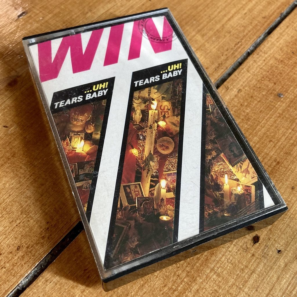 Win 'Uh! Tears Baby (A Trash Icon)' cassette box front