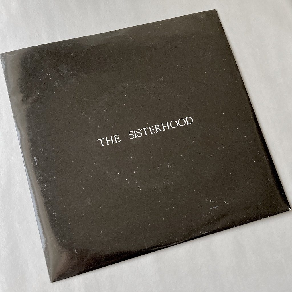 "The Sisterhood - 'Giving Ground' UK 7"" single front cover"