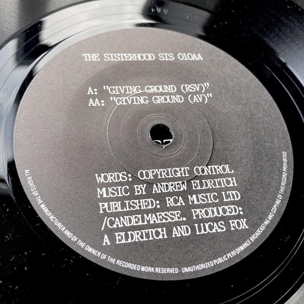 """The Sisterhood - 'Giving Ground' UK 7"""" single label side AA"""