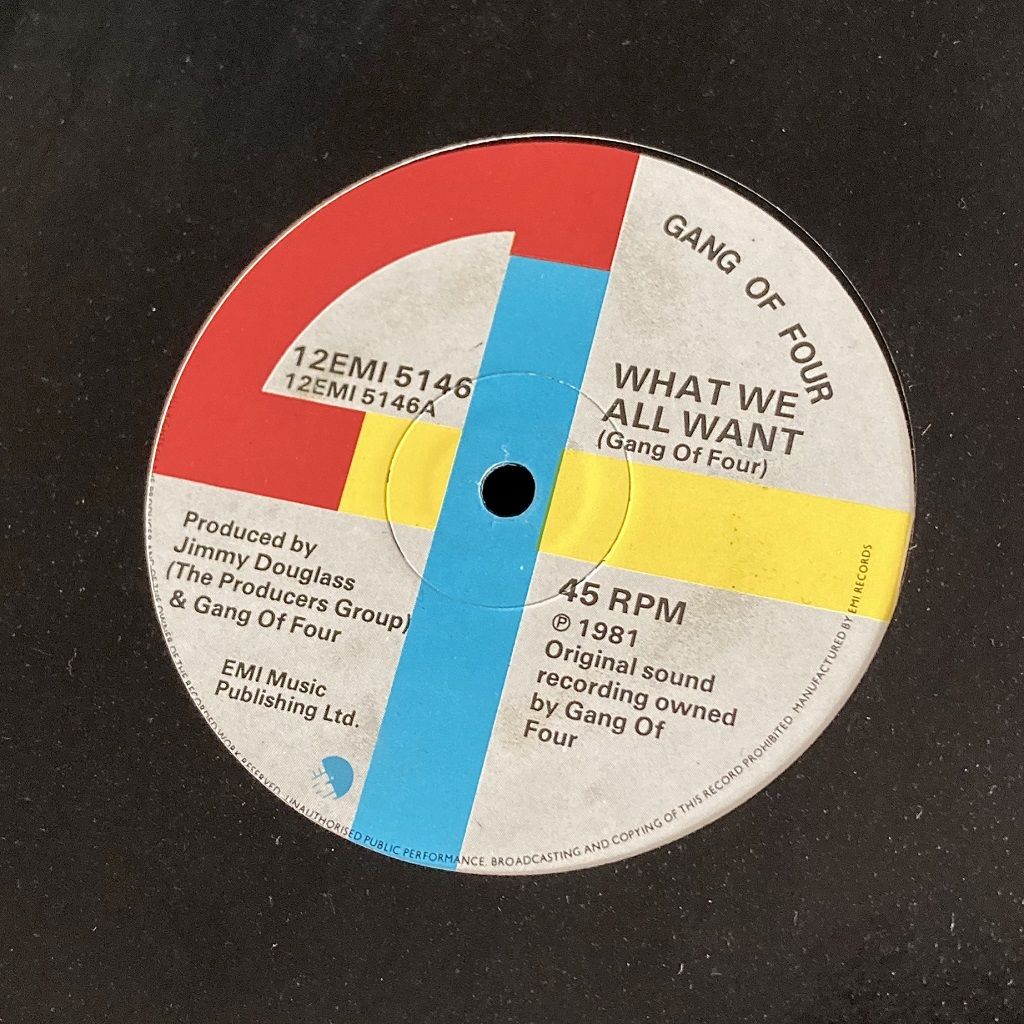 Gang Of Four – 'What We All Want' UK 12″ label side A