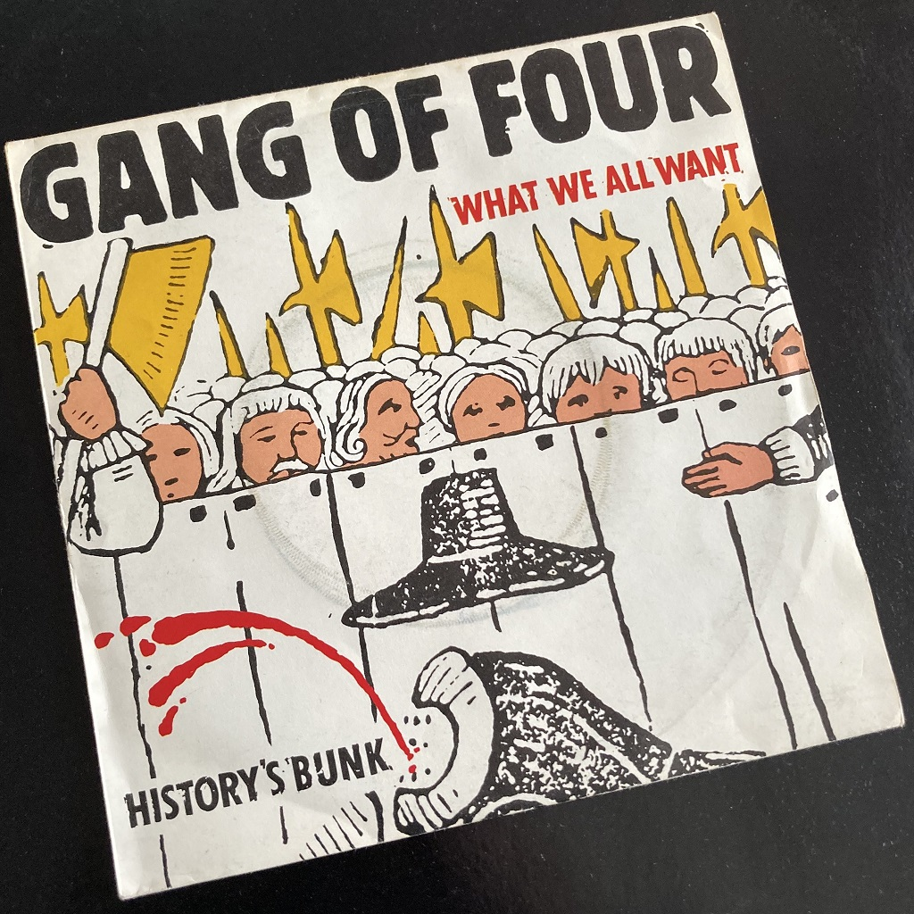 Gang Of Four – 'What We All Want' UK 7″ front cover