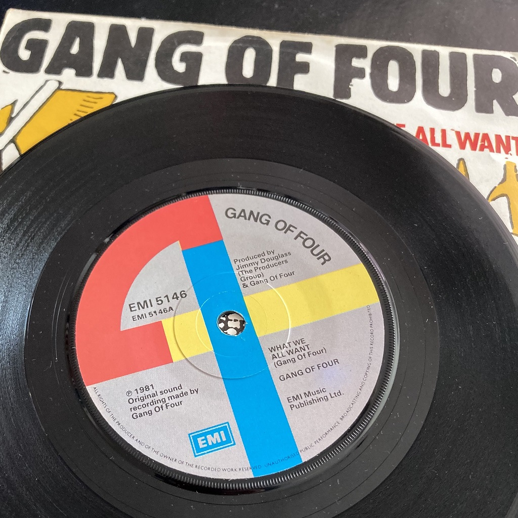Gang Of Four – 'What We All Want' UK 7″ label side A