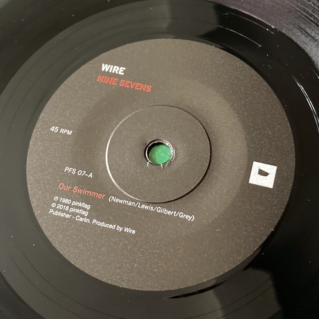 """Wire - 'Our Swimmer' 7"""" label side A from 2018 'Nine Sevens' box set"""