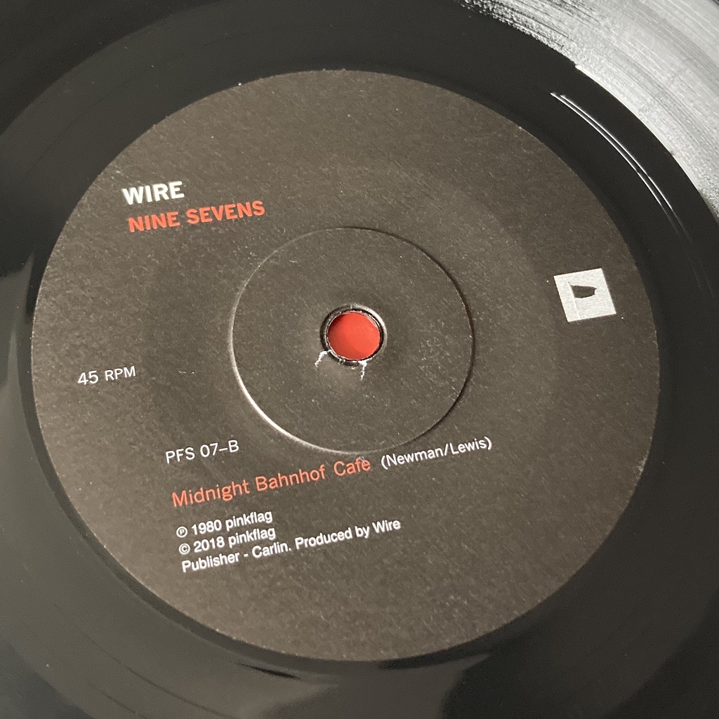 """Wire - 'Our Swimmer' 7"""" label side B from 2018 'Nine Sevens' box set"""