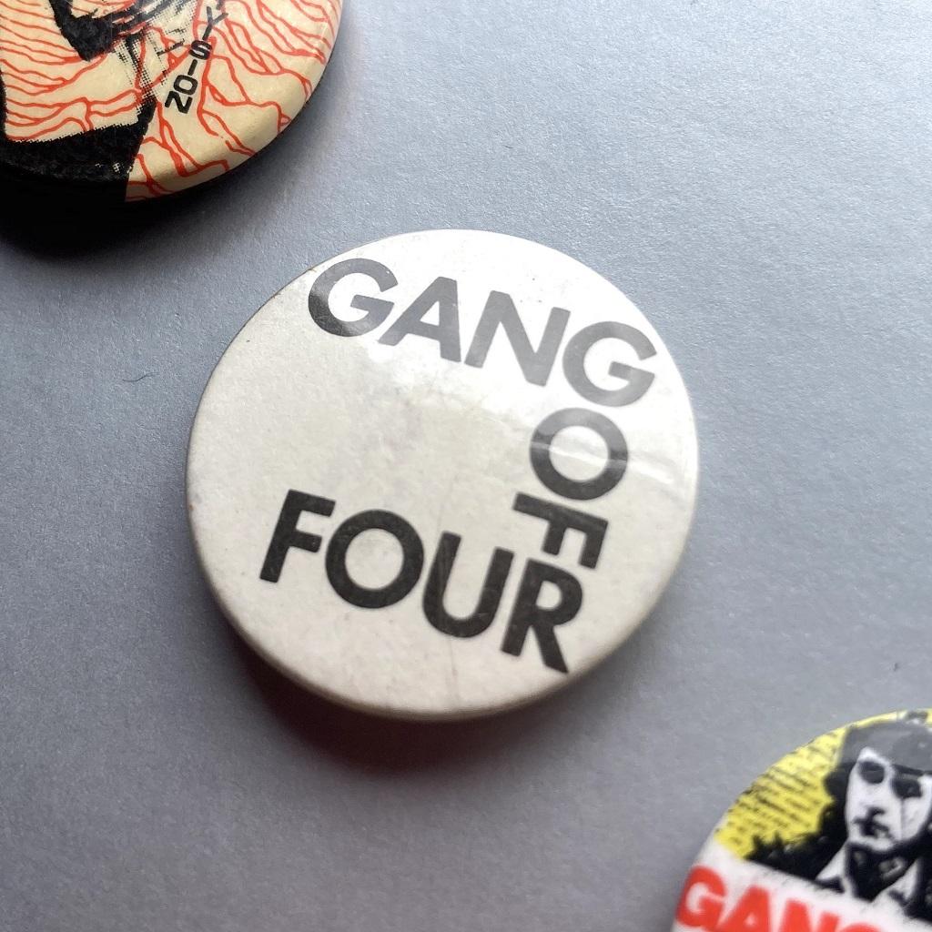 Gang of Four logo badge black type on white