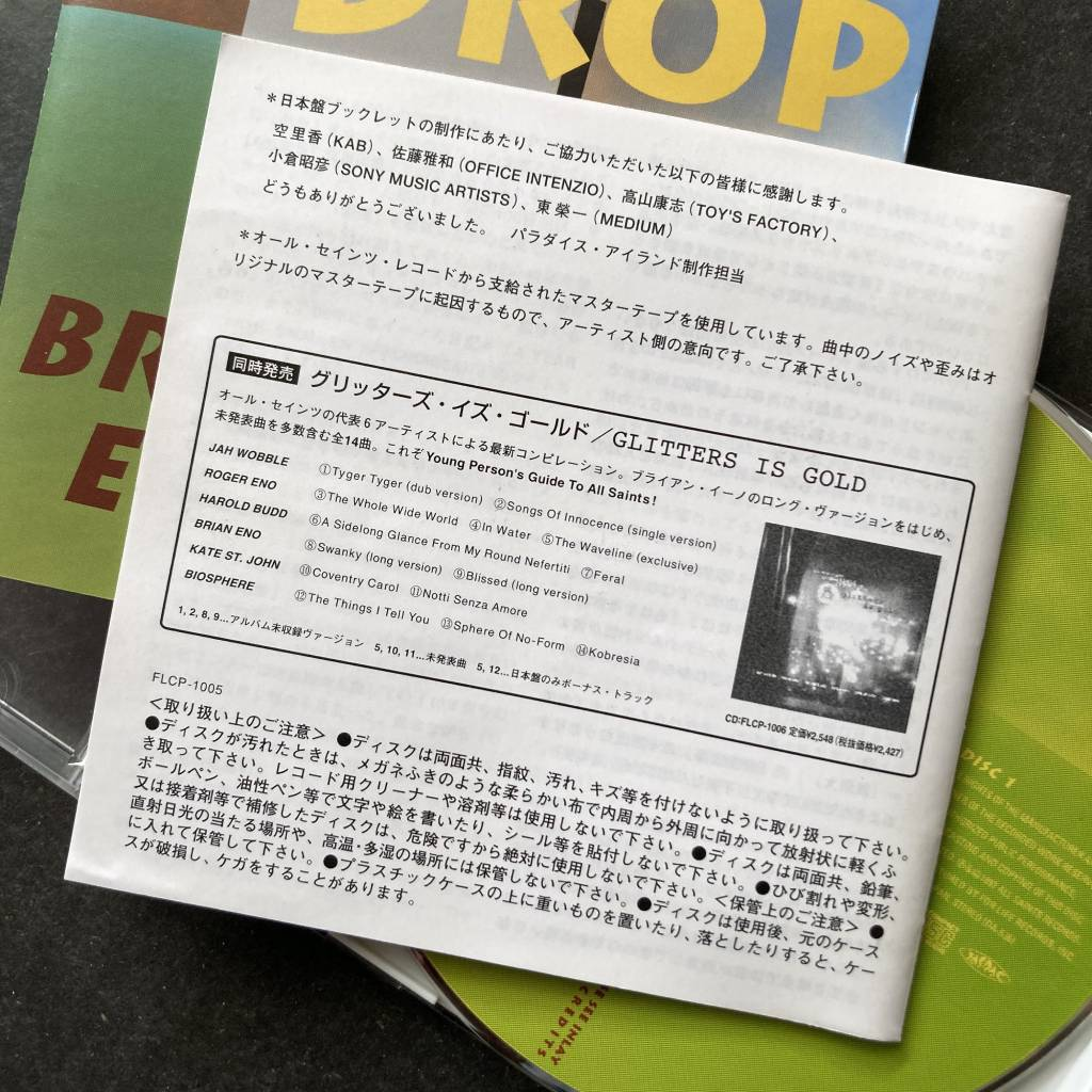 Brian Eno - 'The Drop' - 1997 Japanese 2 x CD edition - additional booklet - rear cover with 'Glitters Is Gold' promo