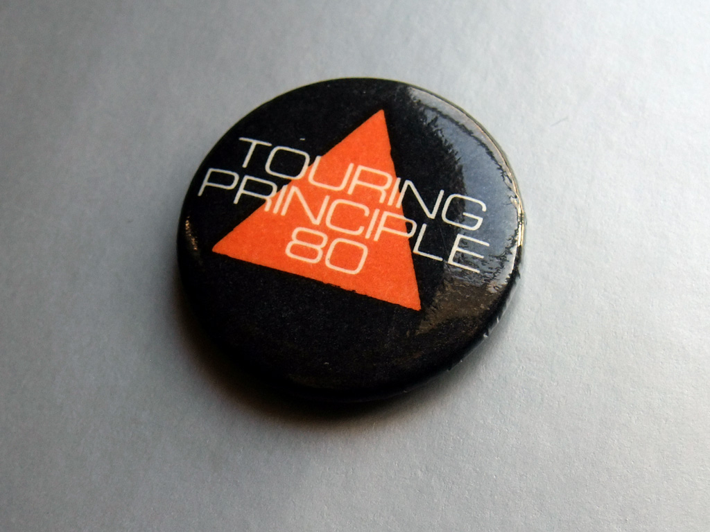 Gary Numan - Touring Principle 80 red triangle/black background button badge