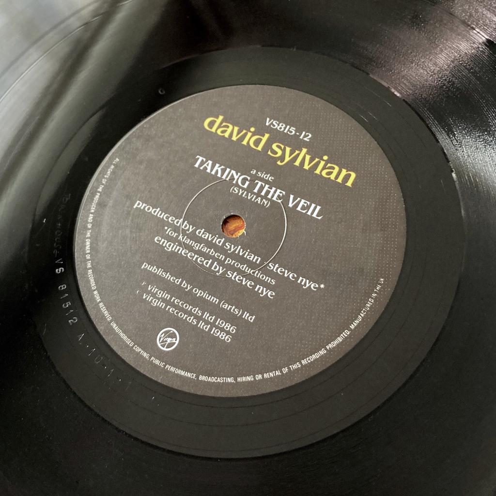 "David Sylvian - 'Taking The Veil' UK 12"" single - label side A"